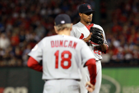 ARLINGTON, TX - OCTOBER 23:  Pitching coach Dave Duncan visits Edwin Jackson #22 of the St. Louis Cardinals on the mound during Game Four of the MLB World Series against the Texas Rangers at Rangers Ballpark in Arlington on October 23, 2011 in Arlington, Texas.  (Photo by Ronald Martinez/Getty Images)