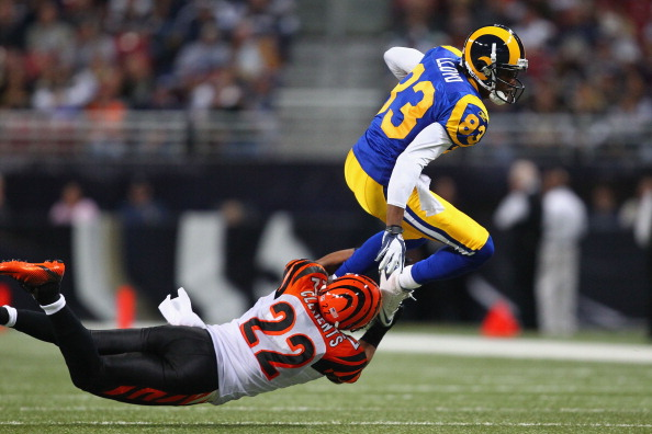 ST. LOUIS, MO - DECEMBER 18: Nate Clements #22 of the Cincinnati Bengals tackles Brandon Lloyd #83 of the St. Louis Rams at the Edward Jones Dome on December 18, 2011 in St. Louis, Missouri.  (Photo by Dilip Vishwanat/Getty Images)