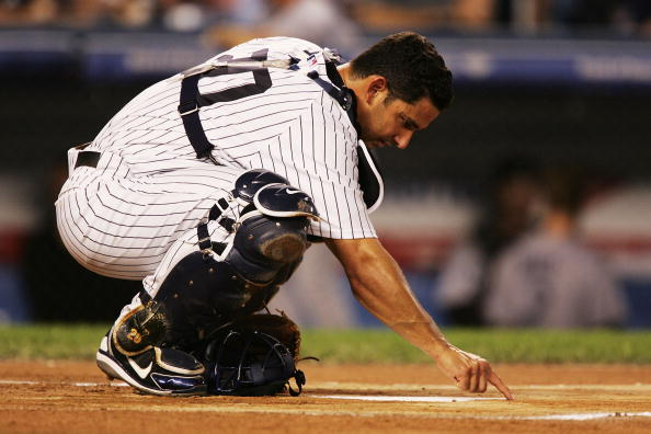 NEW YORK - SEPTEMBER 23:  Catcher Jorge Posada #20 of the New York Yankees draws on home plate before the start of the game against the Toronto Blue Jays on September 23, 2005 at Yankee Stadium in the Bronx borough of New York City.  (Photo by Al Bello/Getty Images)