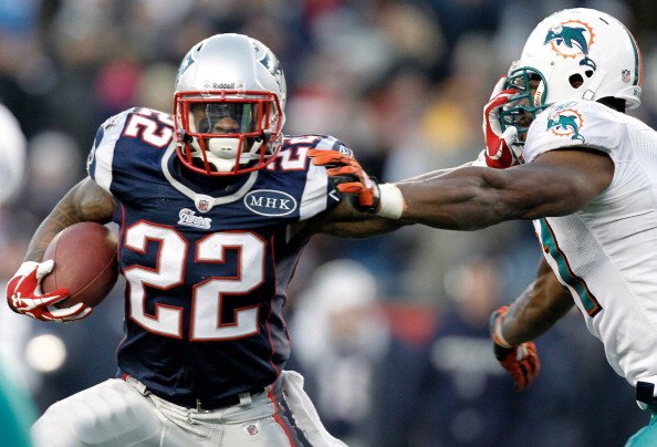 FOXBORO, MA - DECEMBER 24:  Stevan Ridley #22 of the New England Patriots stiff arms Cameron Wake #91 of the Miami Dolphins during the fourth quarter of New England's 27-24 win at Gillette Stadium on December 24, 2011 in Foxboro, Massachusetts.  (Photo by Winslow Townson/Getty Images)