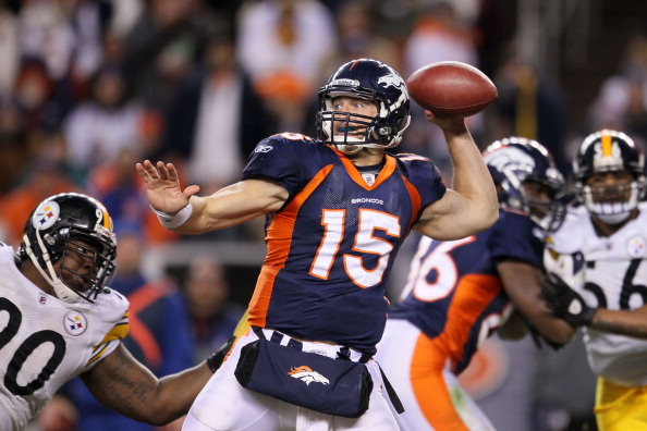 DENVER, CO - JANUARY 08:  Tim Tebow #15 of the Denver Broncos looks to pass against the Pittsburgh Steelers during the AFC Wild Card Playoff game at Sports Authority Field at Mile High on January 8, 2012 in Denver, Colorado.  (Photo by Jeff Gross/Getty Images)