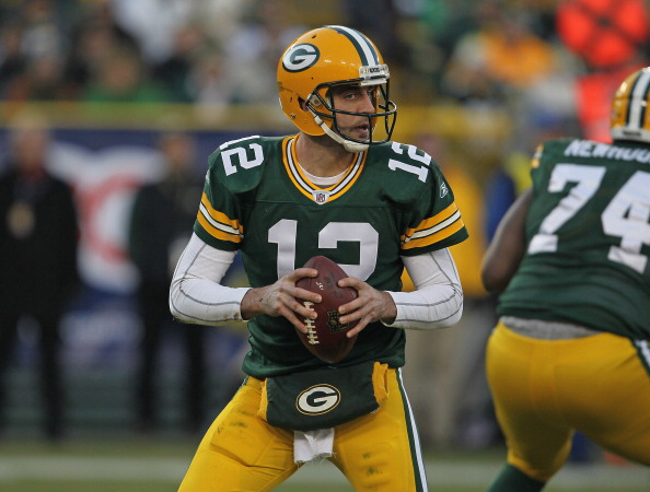GREEN BAY, WI - DECEMBER 11:  Aaron Rodgers  #12 of the Green Bay Packers looks for a receiver against the Oakland Raiders at Lambeau Field on December 11, 2011 in Green Bay, Wisconsin. The Packers defeated the Raiders 46-16.  (Photo by Jonathan Daniel/Getty Images)