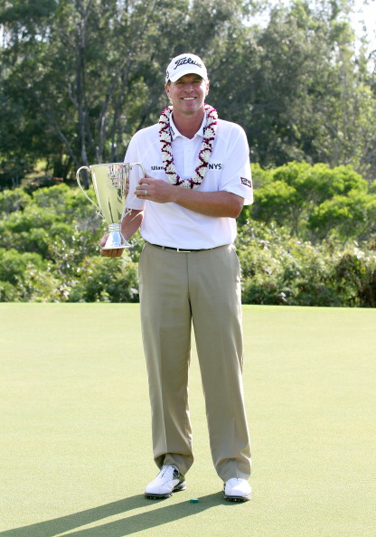 KAPALUA, HI - JANUARY 09:  Steve Stricker holds the trophy after winning the Hyundai Tournament of Champions at the Plantation Course on January 9, 2012 in Kapalua, Hawaii.  (Photo by Sam Greenwood/Getty Images)