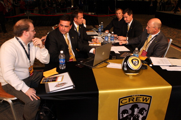 BALTIMORE, MD - JANUARY 13: Coaches and front office staff of the Columbus Crew during the 2011 MLS SuperDraft on January 13, 2011 at the Baltimore Convention Center in Baltimore, Maryland. (Photo by Ned Dishman/Getty Images)