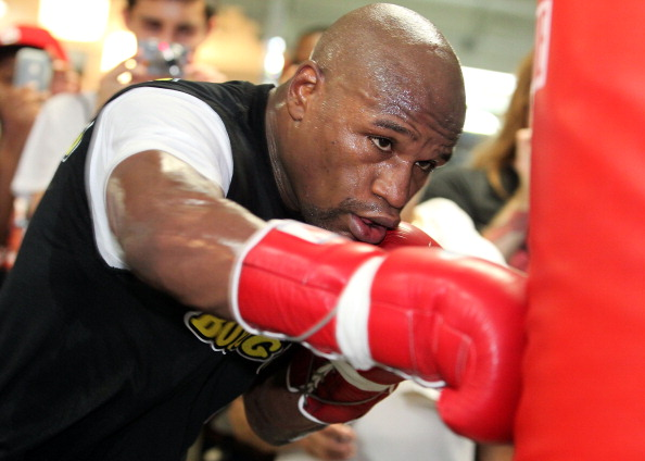 LAS VEGAS, NV - SEPTEMBER 06:  Floyd Mayweather hits the punching bag during his workout training session at his gym on September 6, 2011 in Las Vegas, Nevada.  (Photo by Jeff Bottari/Getty Images)