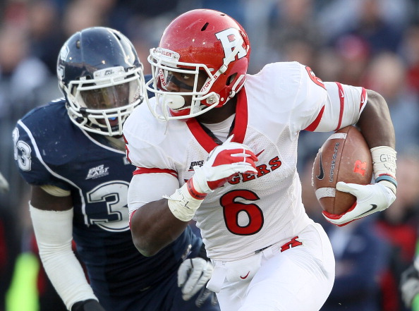 EAST HARTFORD, CT - NOVEMBER 26:  Mohamed Sanu #6 of the Rutgers Scarlet Knights carries the ball as Yawin Smallwood #33 of the Connecticut Huskies defends on November 26, 2011 at Rentschler Field in East Hartford, Connecticut. The Connecticut Huskies defeated the Rutgers Scarlet Knights 40-22.  (Photo by Elsa/Getty Images)