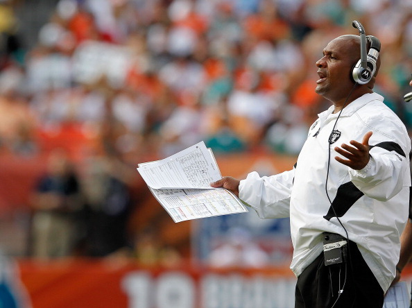 MIAMI GARDENS, FL - DECEMBER 04:  Oakland Raiders head coach Hue Jackson looks on during a game against the Miami Dolphins at Sun Life Stadium on December 4, 2011 in Miami Gardens, Florida.  (Photo by Mike Ehrmann/Getty Images)
