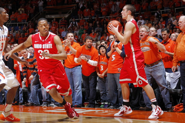 CHAMPAIGN, IL - JANUARY 10: Aaron Craft #4 of the Ohio State Buckeyes takes the ball out of bounds while being taunted by Illinois Fighting Illini fans at Assembly Hall on January 10, 2012 in Champaign, Illinois. The Illini defeated the Buckeyes 79-74. (Photo by Joe Robbins/Getty Images)
