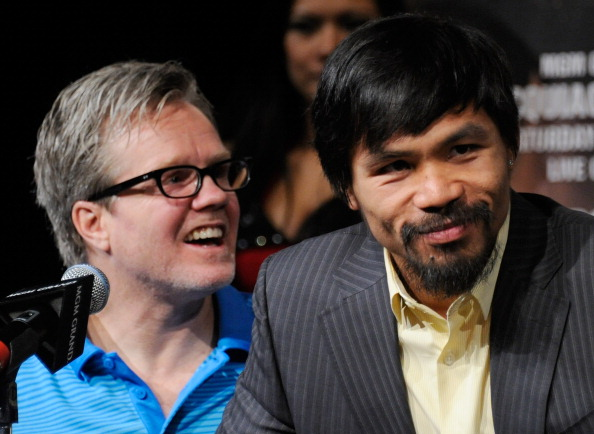 LAS VEGAS, NV - NOVEMBER 09:  Trainer Freddie Roach (L) and boxer Manny Pacquiao appear during the final news conference for Pacquiao's bout with Juan Manuel Marquez at the MGM Grand Hotel/Casino November 9, 2011 in Las Vegas, Nevada. Pacquiao will defend his WBO welterweight title against Marquez when the two meet in the ring for the third time on November 12 in Las Vegas.  (Photo by Ethan Miller/Getty Images)