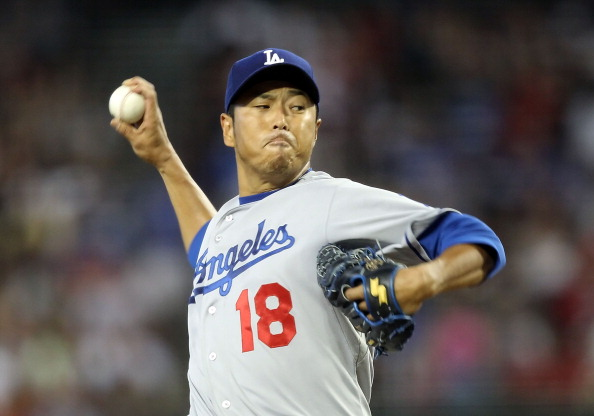 PHOENIX, AZ - JULY 16:  Starting pitcher Hiroki Kuroda #18 of the Los Angeles Dodgers pitches against the Arizona Diamondbacks during the Major League Baseball game at Chase Field on July 16, 2011 in Phoenix, Arizona.  (Photo by Christian Petersen/Getty Images)