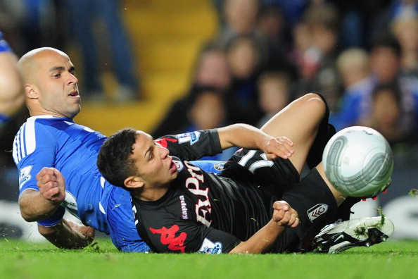 LONDON, ENGLAND - SEPTEMBER 21:  Alex of Chelsea tackles Kerim Frei of Fulham and gives away a penalty kick during the Carling Cup Third Round match between Chelsea and Fulham at Stamford Bridge on September 21, 2011 in London, England.  (Photo by Jamie McDonald/Getty Images).