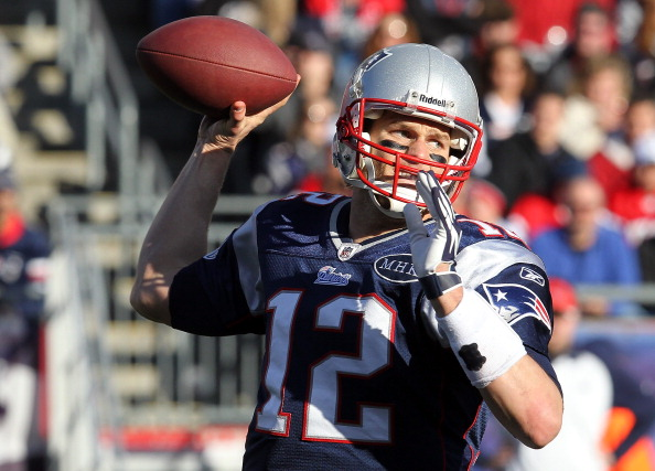 FOXBORO, MA - JANUARY 1:   Tom Brady #12 of the New England Patriots throws against the Buffalo Bills at Gillette Stadium on January 1, 2012 in Foxboro, Massachusetts. (Photo by Jim Rogash/Getty Images)