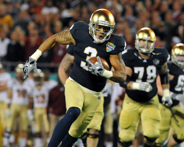 ORLANDO, FL - DECEMBER 29: Wide receiver Michael Floyd #3 of the Notre Dame Fight Irish runs upfield against the Florida State Seminoles in the Champs Sports Bowl December 29, 2011 at the Florida Citrus Bowl in Orlando, Florida.  FSU won 18 - 14. (Photo by Al Messerschmidt/Getty Images)