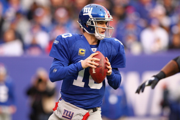 EAST RUTHERFORD, NJ - JANUARY 08:  Eli Manning #10 of the New York Giants looks to pass in the first quarter against the Atlanta Falcons during their NFC Wild Card Playoff game at MetLife Stadium on January 8, 2012 in East Rutherford, New Jersey.  (Photo by Al Bello/Getty Images)