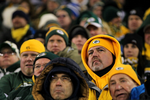 GREEN BAY, WI - JANUARY 15:  A fan of the Green Bay Packers looks on towards the end of the game against the New York Giants during their NFC Divisional playoff game at Lambeau Field on January 15, 2012 in Green Bay, Wisconsin.  (Photo by Jamie Squire/Getty Images)