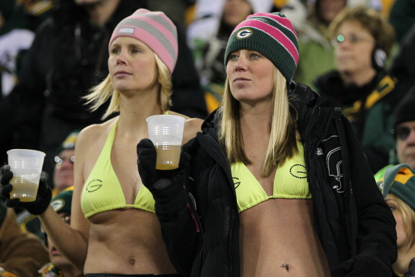 GREEN BAY, WI - JANUARY 15:  Fans of the Green Bay Packers look on towards the end of the game against the New York Giants during their NFC Divisional playoff game at Lambeau Field on January 15, 2012 in Green Bay, Wisconsin.  (Photo by Jamie Squire/Getty Images)