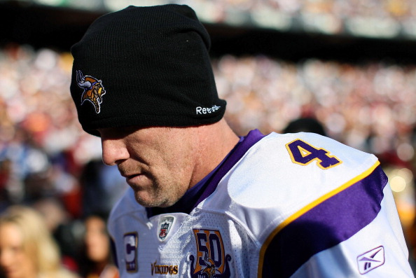 LANDOVER, MD - NOVEMBER 28:  Brett Favre #4 of the Minnesota Vikings walks off the field at the end of the first half against the Washington Redskins at FedExField November 28, 2010 in Landover, Maryland. The Vikings won the game 17-13.  (Photo by Win McNamee/Getty Images)