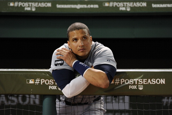 ARLINGTON, TX - OCTOBER 15:  Victor Martinez #41 of the Detroit Tigers reacts after deing defeated in Game Six of the American League Championship Series by the Texas Rangers eliminating them from the playoffs at Rangers Ballpark in Arlington on October 15, 2011 in Arlington, Texas.  (Photo by Harry How/Getty Images)