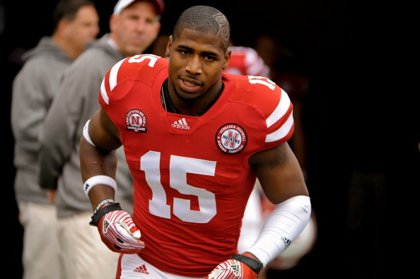 LINCOLN, NE - NOVEMBER 25: Cornerback Alfonzo Dennard #15 of the Nebraska Cornhuskers is greeted by Head Coach Bo Pelini on senior day before playing a  game against the Iowa Hawkeyes at Memorial Stadium November 25, 2011 in Lincoln, Nebraska. Nebraska defeated Iowa 20-7. (Photo by Eric Francis/Getty Images)