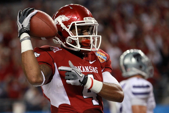 ARLINGTON, TX - JANUARY 06:  Jarius Wright #4 of the Arkansas Razorbacks celebrates a touchdown pass reception against the Kansas State Wildcats during the Cotton Bowl at Cowboys Stadium on January 6, 2012 in Arlington, Texas.  (Photo by Ronald Martinez/Getty Images)