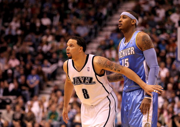 SALT LAKE CITY - APRIL 30:  Deron Williams #8 of the Utah Jazz boxes out Carmelo Anthony #15 of the Denver Nuggets in Game Six of the Western Conference Quarterfinals of the 2010 NBA Playoffs at EnergySolutions Arena on April 30, 2010 in Salt Lake City, Utah. NOTE TO USER: User expressly acknowledges and agrees that, by downloading and or using this photograph, User is consenting to the terms and conditions of the Getty Images License Agreement.  (Photo by Ezra Shaw/Getty Images)