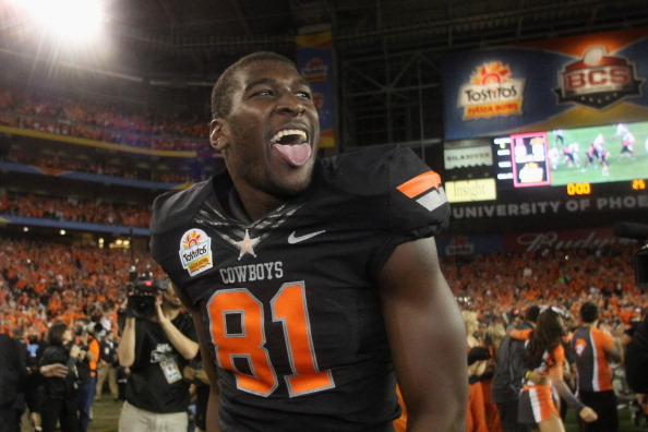 GLENDALE, AZ - JANUARY 02:  Justin Blackmon #81 of the Oklahoma State Cowboys celebrates after Oklahoma State Cowboys won 41-38 in overtime against the Stanford Cardinal during the Tostitos Fiesta Bowl on January 2, 2012 at University of Phoenix Stadium in Glendale, Arizona.  (Photo by Donald Miralle/Getty Images)