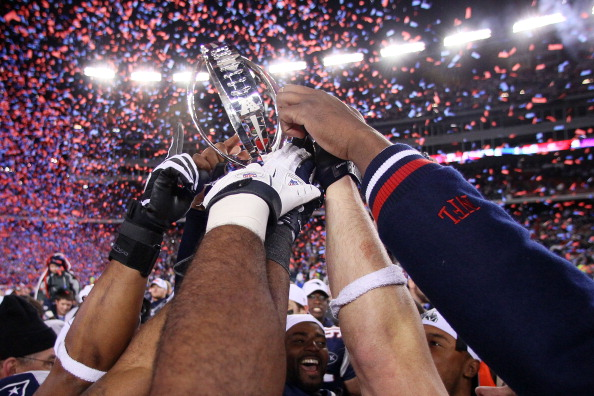 FOXBORO, MA - JANUARY 22:  The New England Patriots celebrates with the Lamar Hunt Trophy after their AFC Championship Game at Gillette Stadium on January 22, 2012 in Foxboro, Massachusetts. The New England Patriots defeated the Baltimore Ravens 20-23.  (Photo by Elsa/Getty Images)