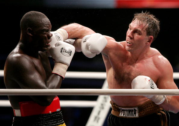 MOSCOW - DECEMBER 10:  Oleg Maskaev (R) of Russia in action against Peter Okhello of Uganda during the WBC Heavyweight title fight on December 10, 2006 in Moscow, Russia. (Photo by Dima Korotayev/Epsilon/Getty Images)