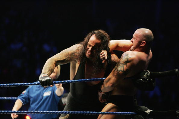 SYDNEY, AUSTRALIA - JUNE 15:  The Undertaker (L) pushes Bam Neely into the corner during WWE Smackdown at Acer Arena on June 15, 2008 in Sydney, Australia.  (Photo by Gaye Gerard/Getty Images)