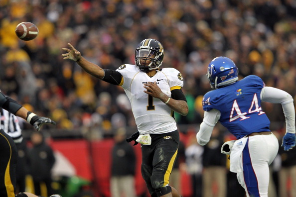 KANSAS CITY, MO - NOVEMBER 26:  Quarterback James Franklin #1 of the Missouri Tigers passes as he is persued by linebacker Malcolm Walker #44 of the Kansas Jayhawks during the game on November 26, 2011 at Arrowhead Stadium  in Kansas City, Missouri.  (Photo by Jamie Squire/Getty Images)