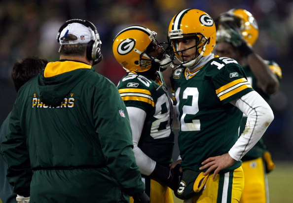 GREEN BAY, WI - JANUARY 15:   Aaron Rodgers #12 of the Green Bay Packers reacts after a play against the New York Giants during their NFC Divisional playoff game at Lambeau Field on January 15, 2012 in Green Bay, Wisconsin.  (Photo by Scott Boehm/Getty Images)