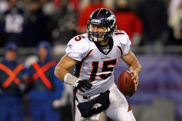 FOXBORO, MA - JANUARY 14:  Tim Tebow #15 of the Denver Broncos looks to pass against the New England Patriots during their AFC Divisional Playoff Game at Gillette Stadium on January 14, 2012 in Foxboro, Massachusetts.  (Photo by Al Bello/Getty Images)