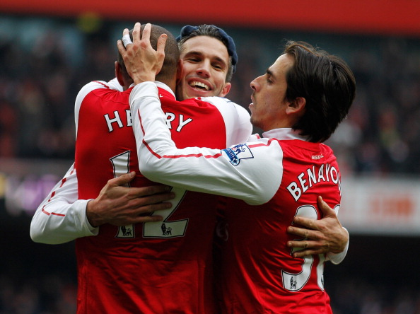 LONDON, ENGLAND - FEBRUARY 04:  Thierry Henry, Robin van Persie and Yossi Benayoun celebrate after Henry scores Arsenals's seventh go during the Barclays Premier League match between Arsenal and Blackburn Rovers at Emirates Stadium on February 4, 2012 in London, England.  (Photo by Paul Gilham/Getty Images)