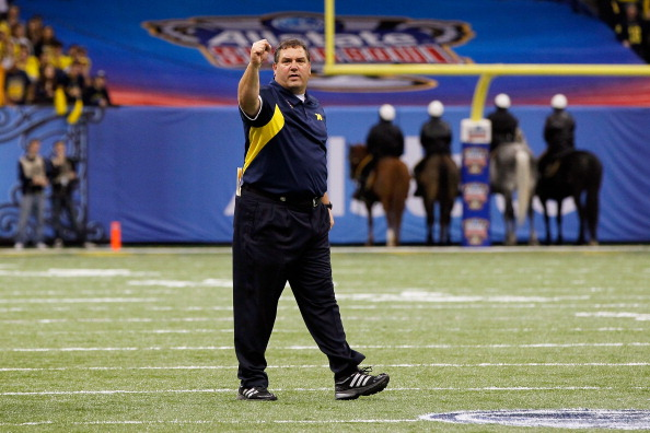 NEW ORLEANS, LA - JANUARY 03:  Head coach Brady Hoke of the Michigan Wolverines coaches against the Virginia Tech Hokies during the Allstate Sugar Bowl at Mercedes-Benz Superdome on January 3, 2012 in New Orleans, Louisiana.  (Photo by Kevin C. Cox/Getty Images)