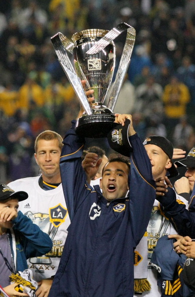 CARSON, CA - NOVEMBER 20:  Juninho #19 of the Los Angeles Galaxy hoists over his head the Philip F. Anschutz Trophy after the Los Angeles Galaxy defeated the Houston Dynamo 1-0 in the 2011 MLS Cup at The Home Depot Center on November 20, 2011 in Carson, California.  (Photo by Victor Decolongon/Getty Images)