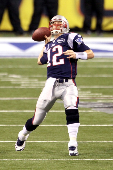INDIANAPOLIS, IN - FEBRUARY 05:  Quarterback Tom Brady #12 of the New England Patriots looks to throw against the New York Giants during Super Bowl XLVI at Lucas Oil Stadium on February 5, 2012 in Indianapolis, Indiana.  (Photo by Jeff Gross/Getty Images)