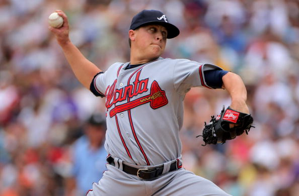 DENVER - JULY 12:  Starting pitcher Kris Medlen #54 of the Atlanta Braves delivers against  the Colorado Rockies during MLB action at Coors Field on July 12, 2009 in Denver, Colorado.  (Photo by Doug Pensinger/Getty Images)