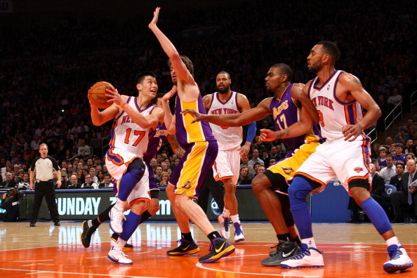 NEW YORK, NY - FEBRUARY 10:  Jeremy Lin #17 of the New York Knicks drives against Pau Gasol #16 of the Los Angeles Lakers in the fourth quarter at Madison Square Garden on February 10, 2012 in New York City.  NOTE TO USER: User expressly acknowledges and agrees that, by downloading and or using this photograph, User is consenting to the terms and conditions of the Getty Images License Agreement.  (Photo by Chris Chambers/Getty Images)