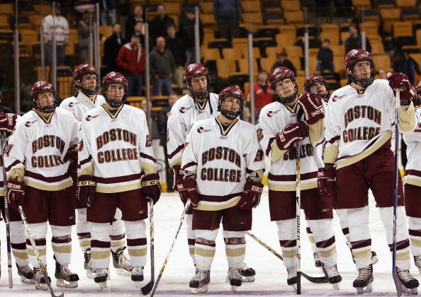 BOSTON - FEBRUARY 12:  Members of the Boston College Eagles watch as the Beanpot trophy is handed to the Boston University Terriers after the Beanpot Tournament Championship Game on February 12, 2007 at TD Banknorth Garden in Boston, Massachusetts. Boston University defeated Boston College 2-1 in overtime. (Photo by Elsa/Getty Images)