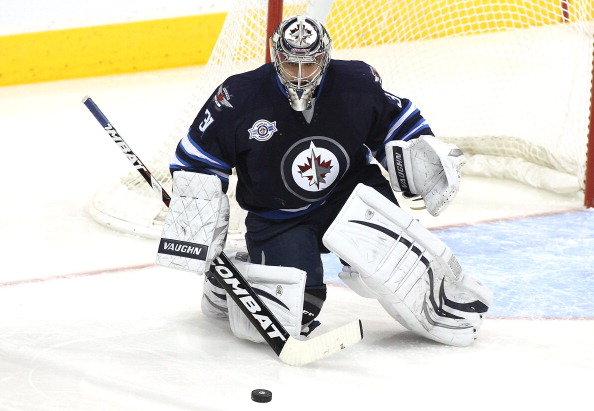 WINNIPEG, CANADA - FEBRUARY 7: Ondrej Pavelec #31 of the Winnipeg Jets blocks a shot on goal during a game against the Toronto Maple Leafs in NHL action at the MTS Centre on February 7, 2012 in Winnipeg, Manitoba, Canada. (Photo by Marianne Helm/Getty Images)