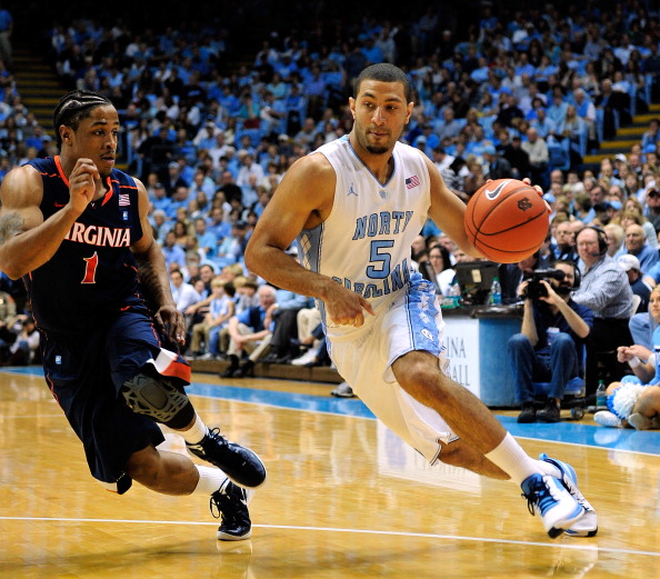 CHAPEL HILL, NC - FEBRUARY 11:  Kendall MArshall #5 of the North Carolina Tar Heels drives against Jontel Evans #1 of the Virginia Cavaliers during play at the Dean Smith Center on February 11, 2012 in Chapel Hill, North Carolina. North Carolina won 70-52.  (Photo by Grant Halverson/Getty Images)