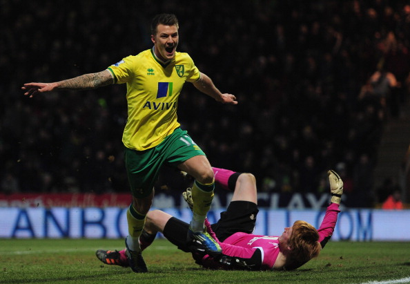 NORWICH, ENGLAND - FEBRUARY 04:  Anthony Pilkington of Norwich City scores a goal during the Barcays Premier League match between Norwich City and Bolton Wanderers at Carrow Road on February 4, 2012 in Norwich, England.  (Photo by Jamie McDonald/Getty Images)