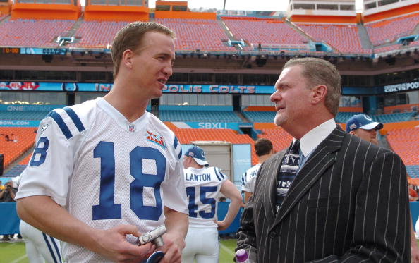 Peyton Manning of the Indianapolis Colts, left, talks with team owner Jim Irsay during Media Day prior to Super Bowl XLI at Dolphins Stadium in Miami, Florida on January 30, 2007. (Photo by A. Messerschmidt/Getty Images)