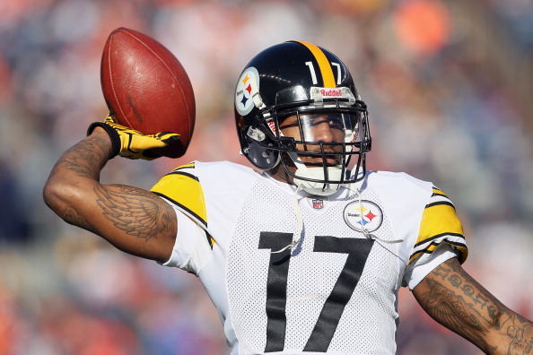DENVER, CO - JANUARY 08:  Mike Wallace #17 of the Pittsburgh Steelers throws the ball prior to the start of the AFC Wild Card Playoff game against the Denver Broncos at Sports Authority Field at Mile High on January 8, 2012 in Denver, Colorado.  (Photo by Jeff Gross/Getty Images)