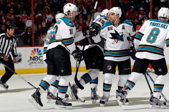 WASHINGTON, DC - FEBRUARY 13:  Patrick Marleau #12 of the San Jose Sharks celebrates with Dan Boyle #22 after scoring in the second period against the Washington Capitals at the Verizon Center on February 13, 2012 in Washington, DC.  San Jose won the game 5-3. (Photo by Greg Fiume/Getty Images)