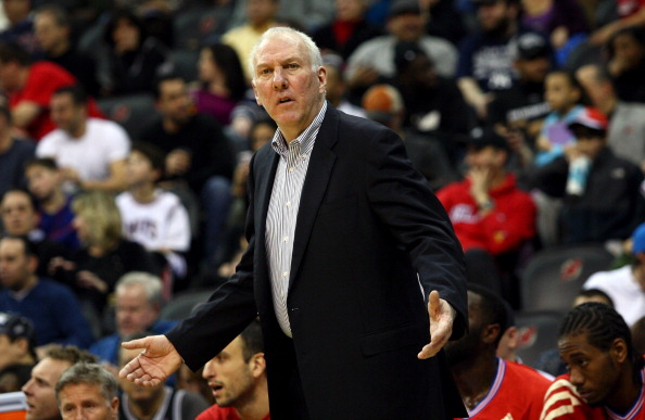 NEWARK, NJ - FEBRUARY 11:  Head coach Gregg Popovich of the San Antonio Spurs reacts as he coaches against the New Jersey Nets at Prudential Center on February 11, 2012 in Newark, New Jersey.  NOTE TO USER: User expressly acknowledges and agrees that, by downloading and or using this photograph, User is consenting to the terms and conditions of the Getty Images License Agreement.  (Photo by Chris Chambers/Getty Images)