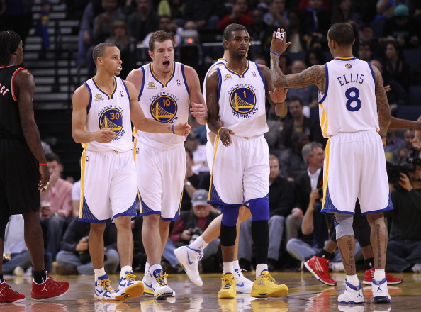 OAKLAND, CA - FEBRUARY 15:  Stephen Curry #30, David Lee #10, Dorell Wright #1 and Monta Ellis #8 of the Golden State Warriors celebrate after a basket during their game against the Portland Trail Blazers at Oracle Arena on February 15, 2012 in Oakland, California. NOTE TO USER: User expressly acknowledges and agrees that, by downloading and or using this photograph, User is consenting to the terms and conditions of the Getty Images License Agreement.  (Photo by Ezra Shaw/Getty Images)