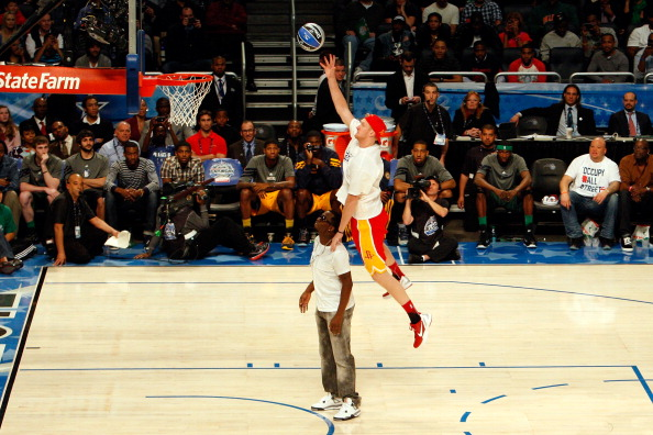 ORLANDO, FL - FEBRUARY 25:  Chase Budinger of the Houston Rockets jumps over entertainer Sean 'P.Diddy' Combs during the Sprite Slam Dunk Contest part of 2012 NBA All-Star Weekend at Amway Center on February 25, 2012 in Orlando, Florida.  NOTE TO USER: User expressly acknowledges and agrees that, by downloading and or using this photograph, User is consenting to the terms and conditions of the Getty Images License Agreement.  (Photo by Mike Ehrmann/Getty Images)