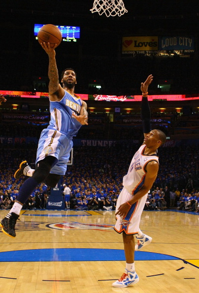 OKLAHOMA CITY, OK - APRIL 20: Wilson Chandler #21 of the Denver Nuggets drives to the basket against Russell Westbrook #0 of the Oklahoma City Thunder in Game Two of the Western Conference Quarterfinals in the 2011 NBA Playoffs on April 20, 2011 at the Ford Center in Oklahoma City, Oklahoma. NOTE TO USER: User expressly acknowledges and agrees that, by downloading and or using this photograph, User is consenting to the terms and conditions of the Getty Images License Agreement. (Photo by Dilip Vishwanat/Getty Images)