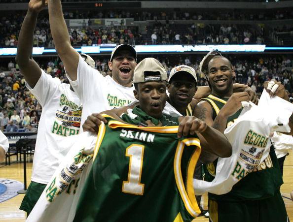 WASHINGTON - MARCH 26:  Tony Skinn #1, Jai Lewis #55 and their teammates celebrate thier win over the Connecticut Huskies during the Regional Finals of the NCAA Men's Basketball Tournament on March 26, 2006 at the Verizon Center in Washington DC. The George Mason Patriots defeated the Connecticut Huskies 86/84.  (Photo by Win McNamee/Getty Images)